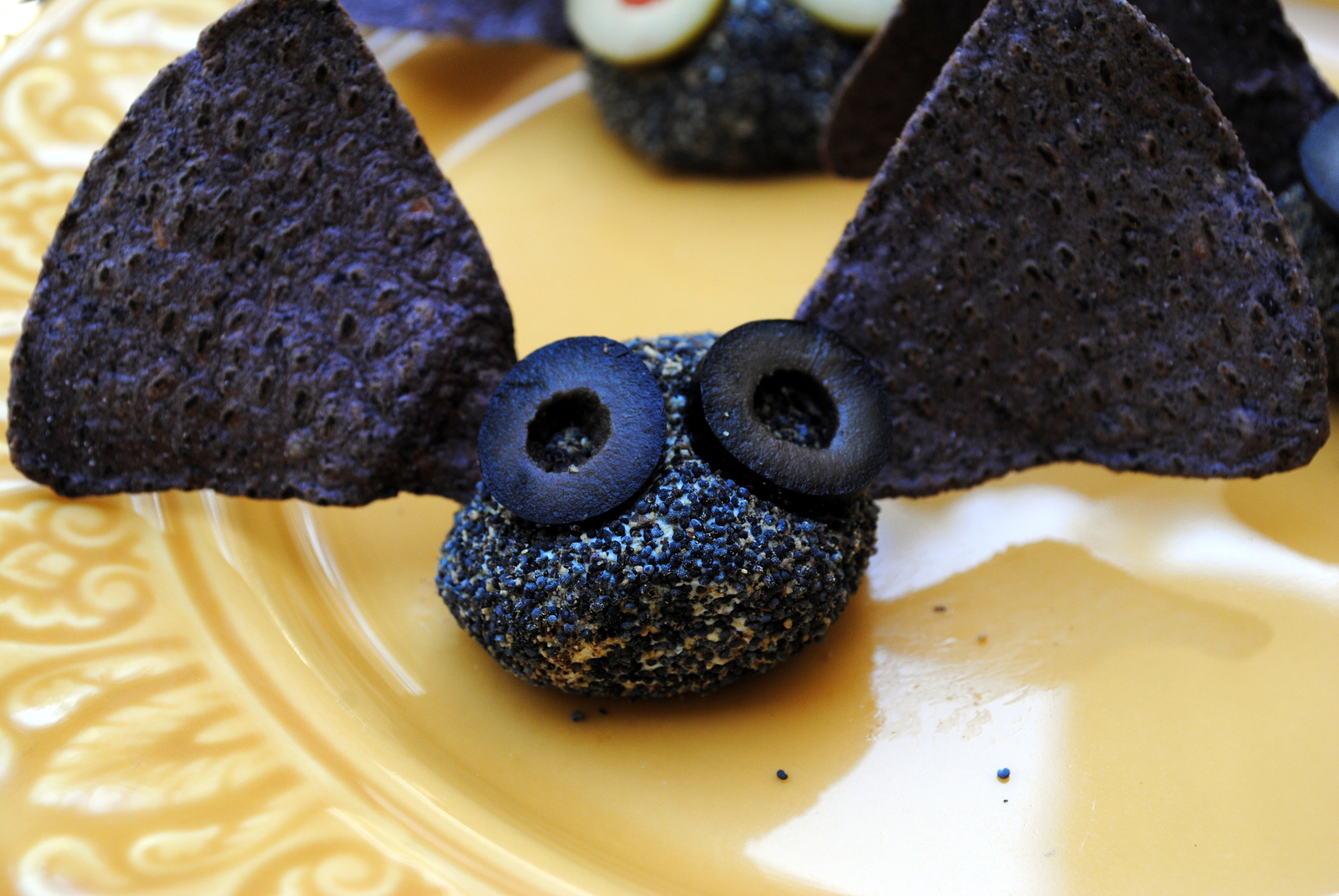 Photos of Bat Bites http://clarecooks.wordpress.com/2011/10/28/halloween-savory-snacks-bat-bites-witches-fingers/